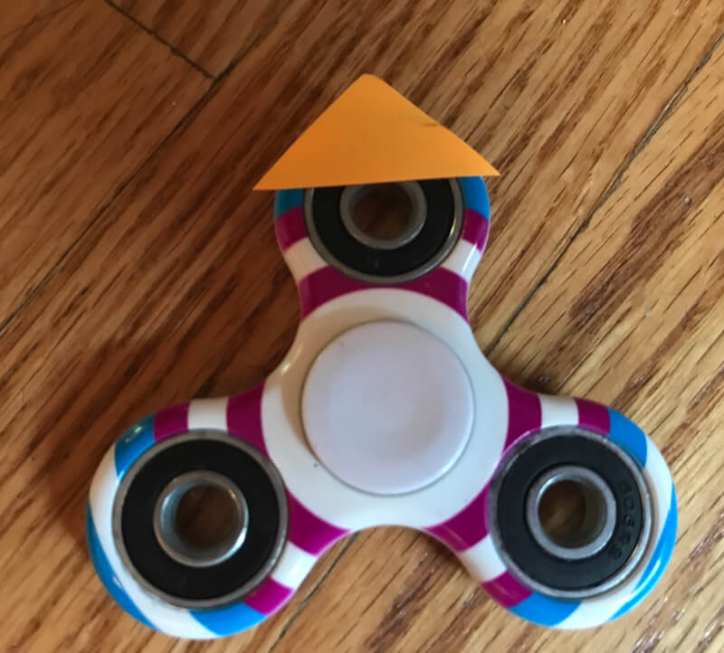 Use a fidget spinner for creative writing. Free printables in the link. www.coffeeandcarpool.com