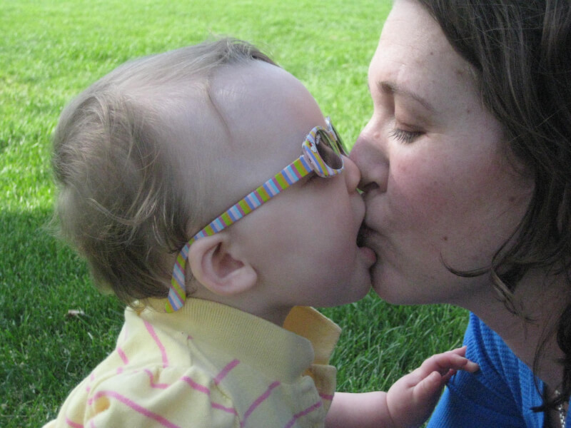 Kissing my daughter on my first Mother's Day. We were finally able to bond and really fall in love with each other because I was able to stop breastfeeding. Here's how I changed it around and finally stopped nursing her as a newborn. www.coffeeandcarpool.com