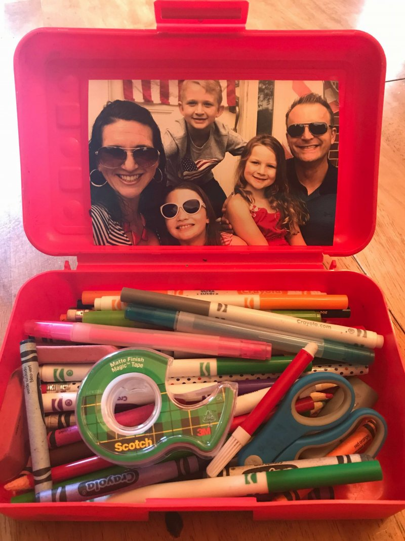 Sneaking a family picture into your child's school supply box can help ease anxiety and homesickness. www.coffeeandcarpool.com