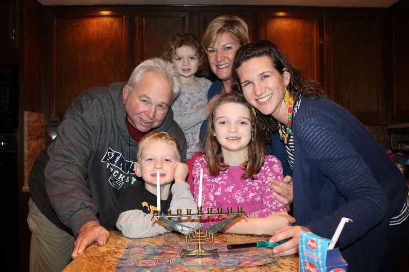 Celebrating Hanukkah with family is a simple way to make Hanukkah more meaningful. #Hanukkah #menorah