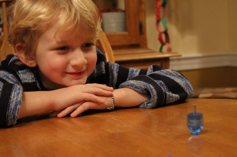 Making Hanukkah more memorable with a dreidel spinning contest #hanukkah #dreidel