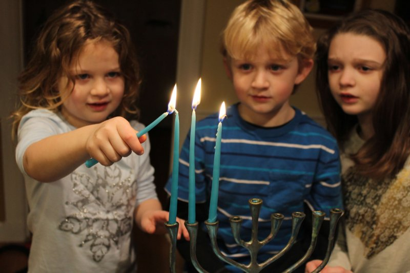 Make Hanukkah more meaningful by letting your kids light the menorah #hanukkah #menorah