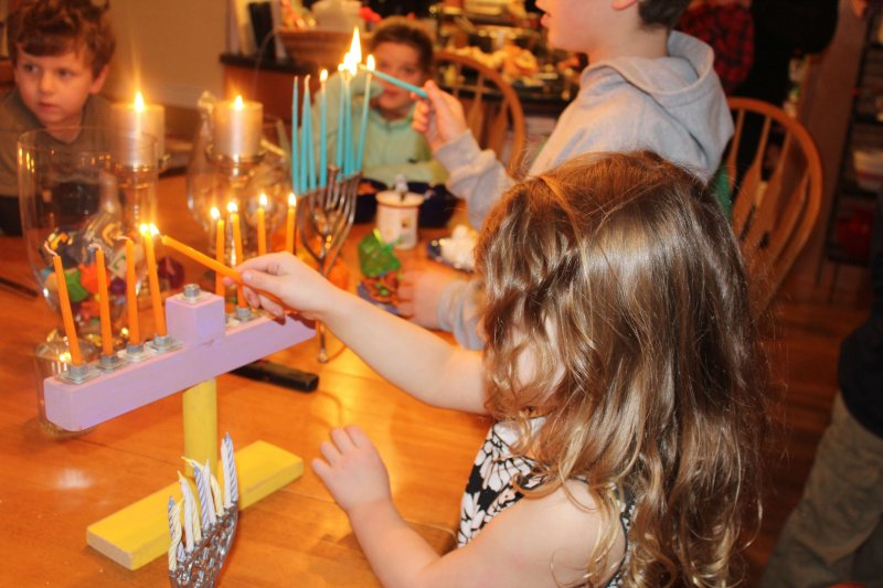Making Hanukkah more meaningful by sharing it with neighbors who don't celebrate. #hanukkah #menorahlighting