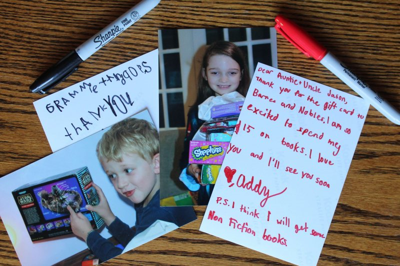 Take photos of kids with their gifts and have kids write their thank you notes on the back of the photo. Free printable to help teach kids how to write thoughtful thank you notes. www.coffeeandcarpool.com #thankyounotes #freeprintable #kidswritingthankyounotes