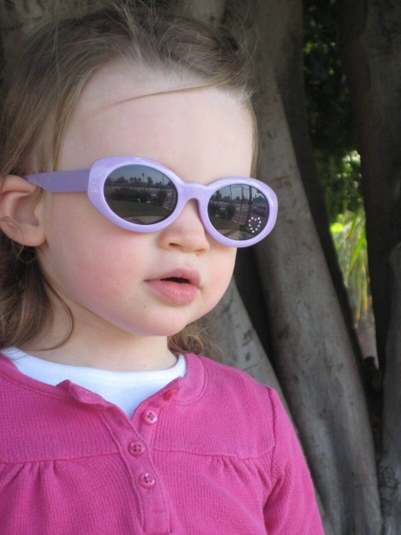 Giving my daughter a choice between pink glasses and purple glasses gave her choices so she felt in control. #positiveparenting #peacefulparenting #parentingadvice