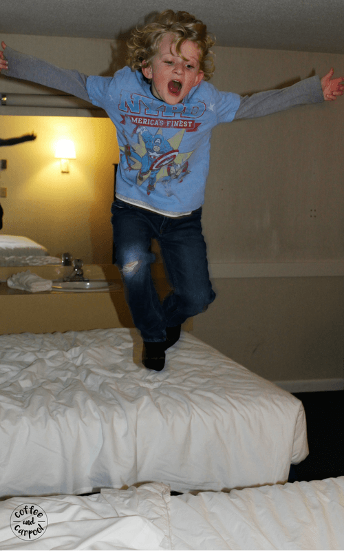 We jump on hotel beds to get our wiggles out before bedtime. #familyvacations #familytrips