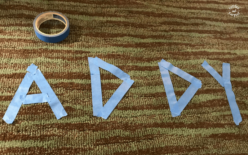 Use painters tape to encourage your kids to decorate the floor of your hotel room #familyvacations