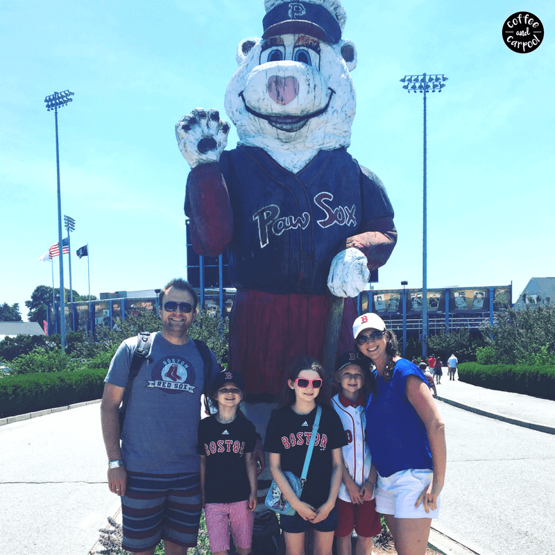 Visiting a minor league baseball team is a great way to connect with your family more. Standing outside PawSox stadium.