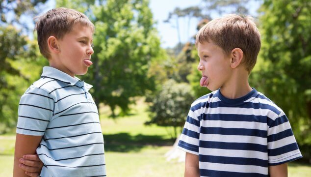 15 surprising things to ban to raise kind kids includes not letting your kids stick their tongues out at each other. #raisekindkids #raisekinderkids #kindkids #positiveparenting101 #coffeeandcarpool