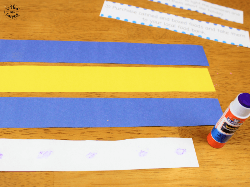 Glue the kindness strips onto the construction paper to make the Hanukkah chain #Hanukkahcrafts #Hanukkah
