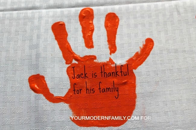 This thankful tablecloth is a sweet Thanksgiving Gratitude Project for families.