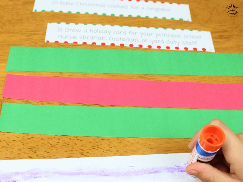 Glue the Kindness Christmas activities onto each paper strip to make the Christmas countdown chain #ChristmasKindness #kindkids