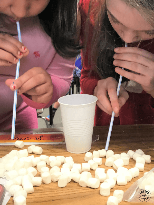 Snowball transfer game with marshmallows is a fun and simple game perfect for winter-themed classroom holiday parties #winterparties #classroomholidayparties #coffeeandcarpool #snowmanparty #winterholidaygames