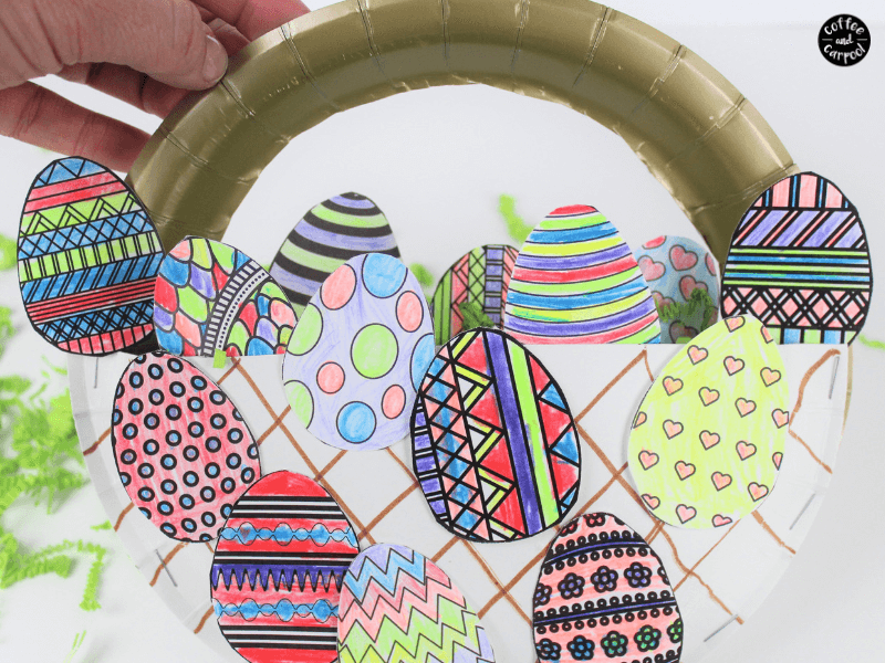 Celebrate Easter with these paper plate crafts for kids that come with this free printable coloring coloring pages for kids with 12 different Easter eggs. Unique Easter crafts for kids are a fun way to celebrate this spring. #springcrafts #paperplatecrafts #eastercrafts #easter #crafts