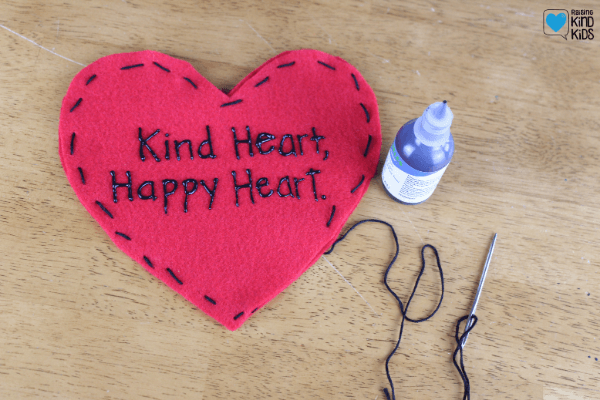 Then continue to sew the two hearts together.